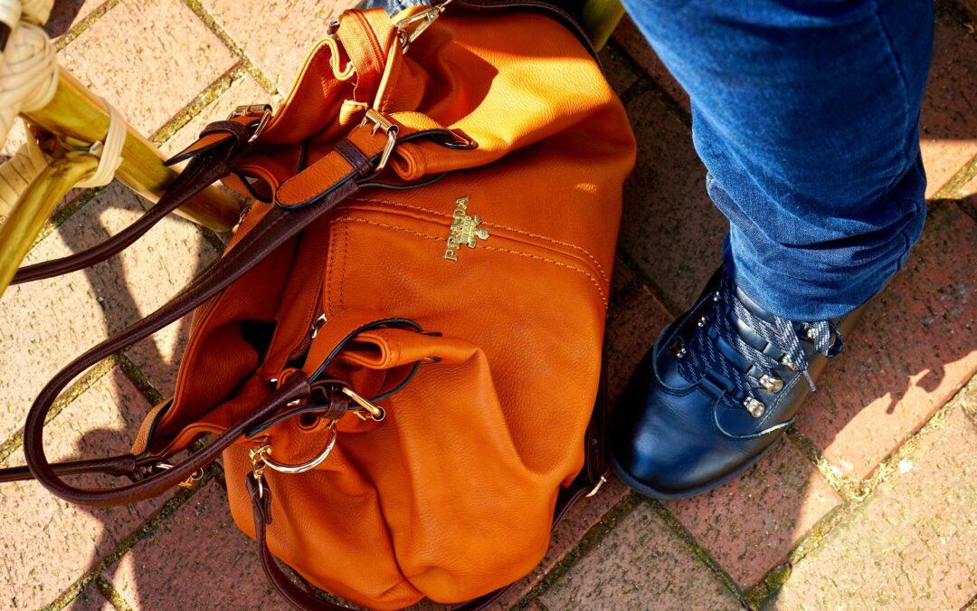 Pronken en paraderen met een Prada tas